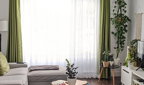 Green curtains in the living room Dubai
